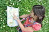 Girl with the city map — Stock Photo