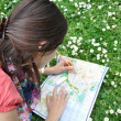 Girl with city map — Photo #3200099