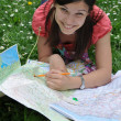 Girl with city map — Photo #3200649