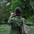 Adventure girl taking a photo in natur — Stock Photo