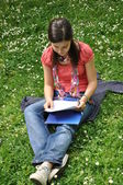 Young student learns in the park — Stock Photo