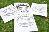 Facial expressions drawn on paper — Stock Photo