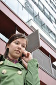 Business woman talking on a mobile phone — Stok fotoğraf