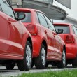 Red cars parked on sunny day — Stock Photo