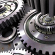 Steel gears in a single mechanism — Stock Photo