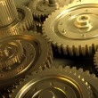 Golden gear in a single mechanism — Stockfoto