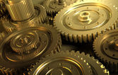 Golden gear in a single mechanism — Stock Photo