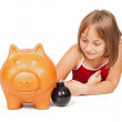 Little girl exploding piggy bank — Stock Photo
