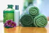 Green towels in bathroom — Stock Photo