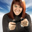 Royalty-Free Stock Photo: Cute redhead playing video games in winter