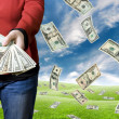 Money falling from the sky - Stock Photo