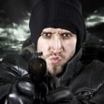 Undercover agent firing gun in the camera — Stock Photo #3047144