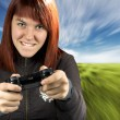 Girl playing video game console — Stock Photo