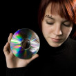 Girl holding a compact disc — Stock Photo