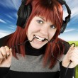 Girl biting headphone cable — Stock Photo