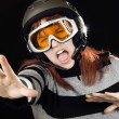 Girl wearing a ski helmet and googles — Stock fotografie