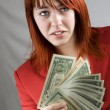 Stock Photo: Surprised girl waving Americdollars