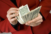 Hands counting dollar banknotes — Stock Photo