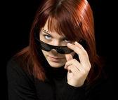 Girl with sunglasses staring at camera — Stock Photo