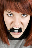 Aggresive girl biting memory stick — Stock Photo