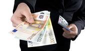 Hand giving Euro banknotes money — Stock Photo