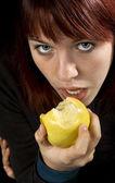 Seductive girl eating apple — Stock Photo