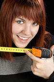 Redhead girl using measuring tape tool — Stock Photo