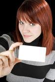Smiling girl holding a blank card — Zdjęcie stockowe