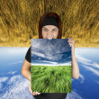 Angry girl holding a nature canvas - Stock Photo