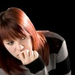 Pensive redhead girl biting nail — Stock Photo #3052386