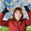 Girl rejoicing a win with dollars falling from t — Stock Photo
