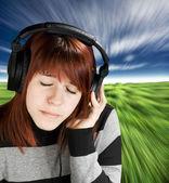 Pensive girl listening to music — Stock Photo