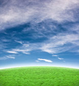 Beautiful blue sky with green hill background — Stock Photo