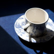 A Chinese tea cup silhouetted - Stock Photo