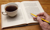Studying with a cup of joe — Stock Photo