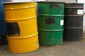 Three industrial barrels in a row — Stock Photo