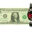 One dollar bill and a watch - Stock Photo
