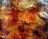 Fresh brown splashing drink — Stock Photo