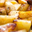 Hot roasted potatoes - Stock Photo