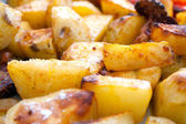Hot roasted potatoes — Stock Photo