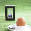 Stock Photo: Boiled egg with sand timer.