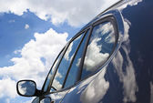 Clouds in the new car. — Stock Photo