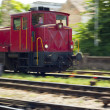 Red train engine in motion — Stock Photo