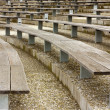 Wooden stadium seats - Stock Photo