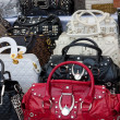 Fake designer hand bags - Stock Photo