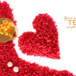 Valentine heart made of red pebbles with golden gift box — Stock Photo #3875346