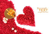 Valentine heart made of red pebbles with golden gift box — Stock Photo