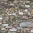 Old wall of stones of a medieval castle — Photo