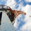 Port crane on a dock - view from below - Stock Photo