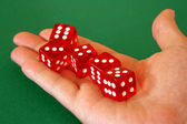 Dice in hand — Stock Photo